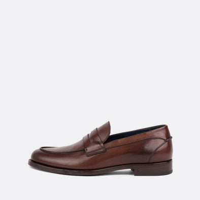Classic polished penny loafer with a beautiful brown upper and leather soles.