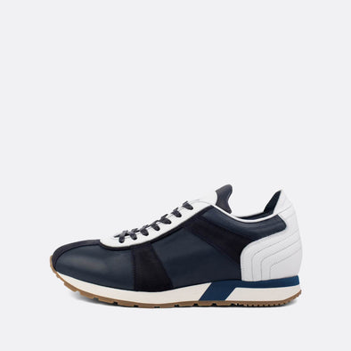 Navy blue leather runners with white details.