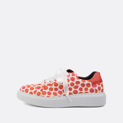 Textured leather white sneakers with red colored dots and satin laces.