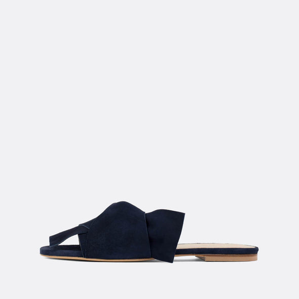 Elegant slides with large knot in navy blue suede.