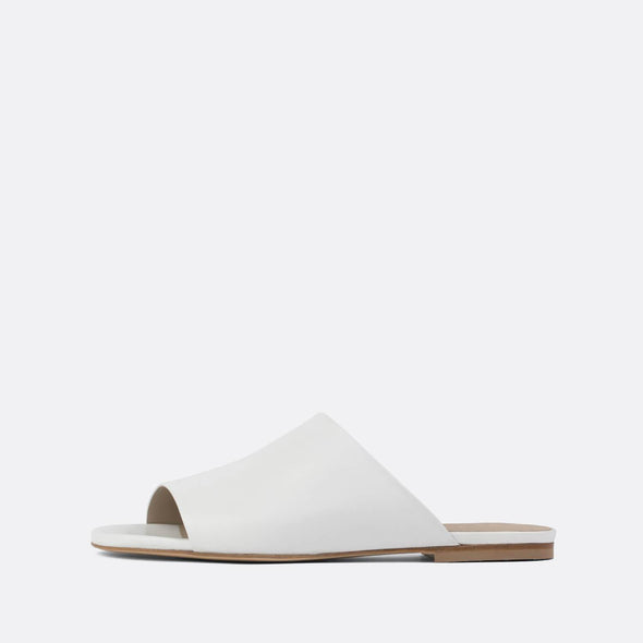 Minimalist one-strap slides in white leather.