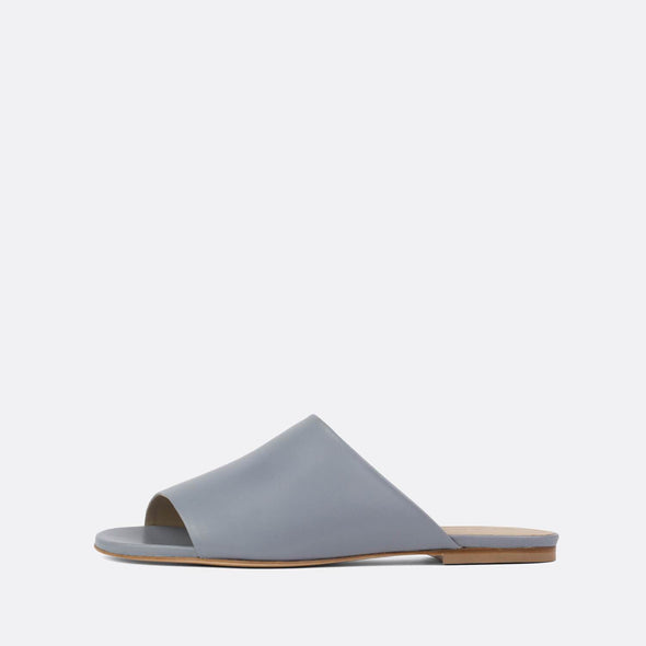 Minimalist one-strap slides in grey leather.