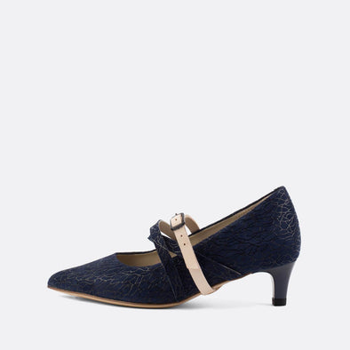 Navy blue patterned kitten heel pumps with classic pointed toe and distinct straps.