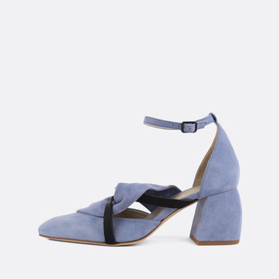 Exquisite pastel blue suede heels with elegantly knotted strap and black leather strap.