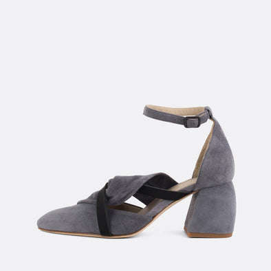 Exquisite grey suede heels with elegantly knotted strap and black leather strap.