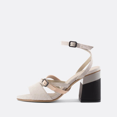 Elegant nuage heeled open sandals with irreverent pattern and black block heel.