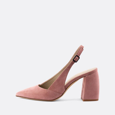 Pointed toe pink suede slingback pump heels featuring a pointed toe design, ankle buckle and contrasting black curved heel.