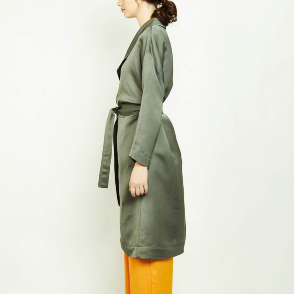 Timless green oversized trench coat with belt.