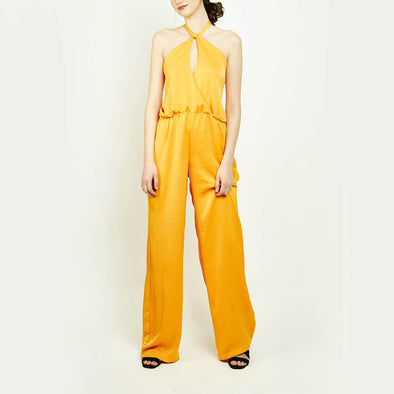 Orange party backless jumpsuit with wide long pants.