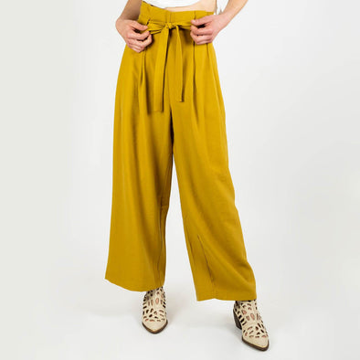 Awkward length mustard trousers with a paperbag waist and pleating around the waistband to add fullness.