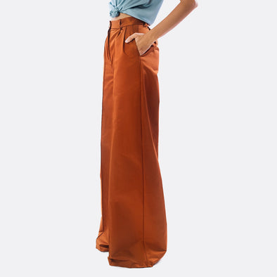 Copper full length pleated trousers with extra wide-leg silhouette.