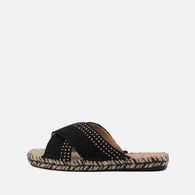 Black flat espadrille slides with crossed upper and natural jute sole.