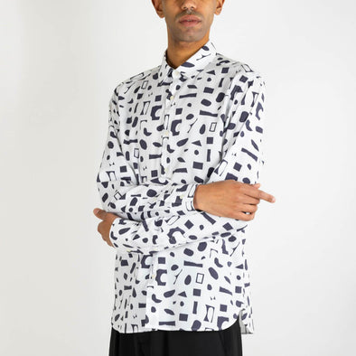 White long sleeved shirt with blue pattern created in collaboration with the artist Elleonor.
