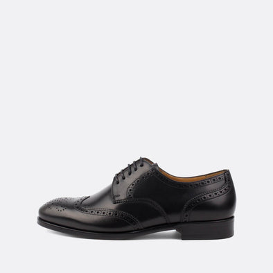 Classic black leather derby shoes with wingtip brogue.