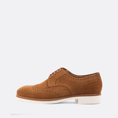 Elegant camel brown suede oxford shoes with white sole.