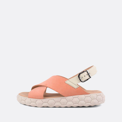 Flat salmon cross-strap sandals featuring a detailed chunky nude sole.