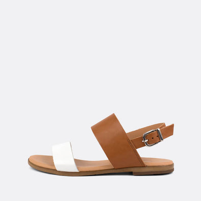 Flat double-strap sandals in brown and white leather.