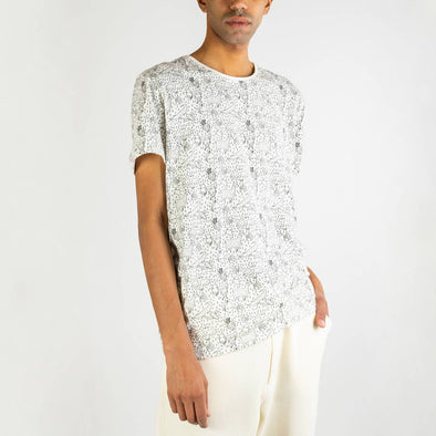 White t-shirt with floral wildlife all over print.