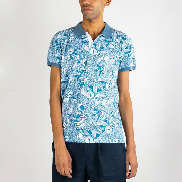 Short sleeved polo shirt with all over blue floral print by Boa Mistura.