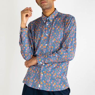 Long sleeved shirt with floral print, button down mod collar and genuine mother of pearl buttons.