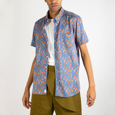 Short sleeved shirt with floral print design, button down mod collar, rounded pocket to left breast and genuine mother of pearl buttons.