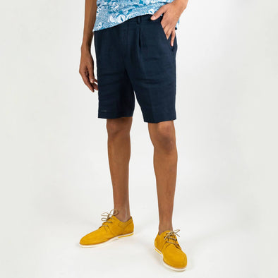 Smart-casual navy blue shorts with 2 reverse welt pockets and small pleats to the front waist area.