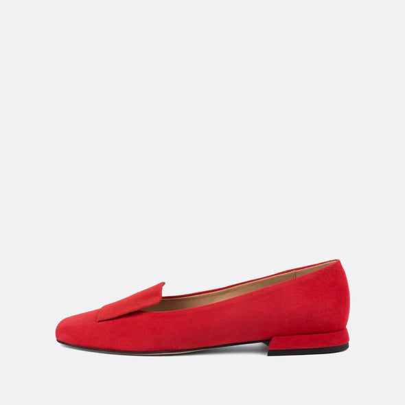 Sophisticated flat loafers in vibrant red suede.