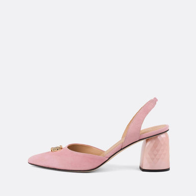 Baby pink suede slingback pumps with distinct heel and diamante detail.