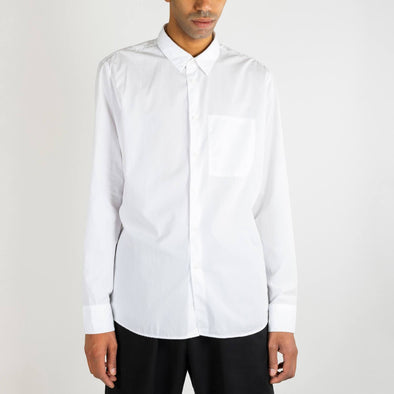 White Italian organic cotton shirt with inside chest pocket and natural mother-of-pearl buttons.