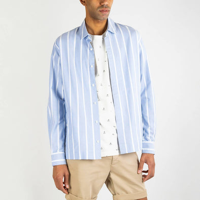 Italian oxford cotton shirt with white and blue stripes, two side pockets and natural mother-of-pearl buttons.
