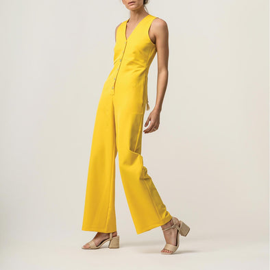 Long yellow jumpsuit with cotton rope detail in the back.