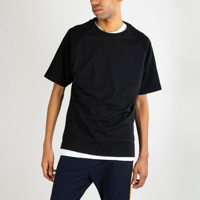 Black relaxed fit 100% organic cotton tee with locked seams which enable the garment to be reversed.