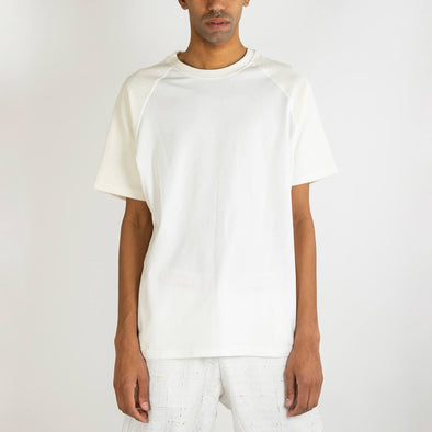 Off-white relaxed fit 100% organic cotton tee with locked seams which enable the garment to be reversed.