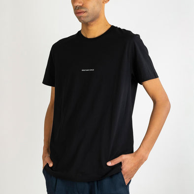 Black tee with 'Ashley Marc Hovelle' printed across the chest and invisible stab stitch at hems.