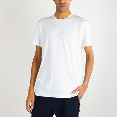 White tee with 'Ashley Marc Hovelle' printed across the chest and invisible stab stitch at hems.