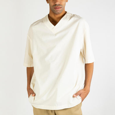 Off-white oversized fit V neck with zen fit in super lightweight organic cotton.