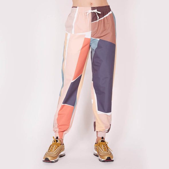Water-resistant, relaxed fit track pants with an elastic waist.