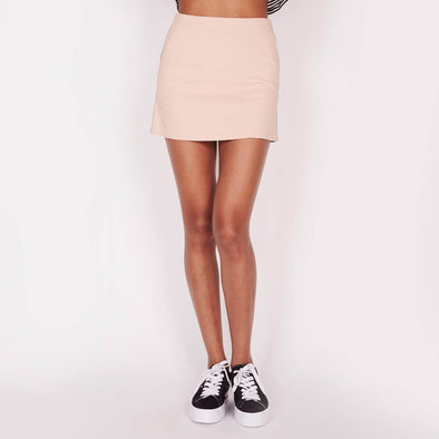 Figure-flattering A-line silhouette nude skirt with side pockets.