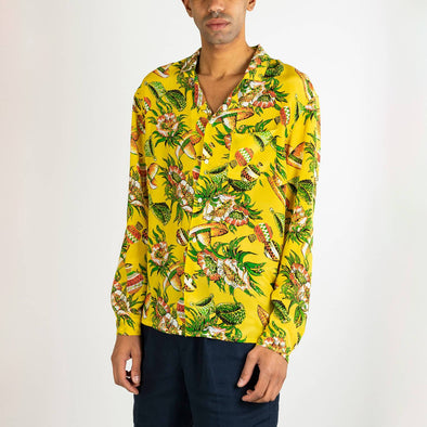 Long sleeved hawaiian shirt in yellow with a multicolored print.