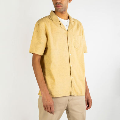 Short sleeved hawaiian ochre shirt with a front chest pocket and mother pearl buttons.