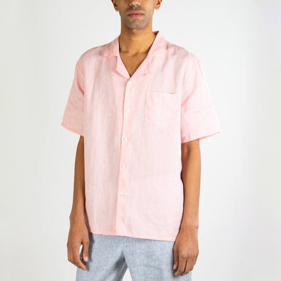 Short sleeved hawaiian gum pink shirt with a front chest pocket and mother pearl buttons.