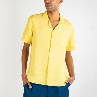 Short sleeved hawaiian lemonade yellow shirt with a front chest pocket and mother pearl buttons.