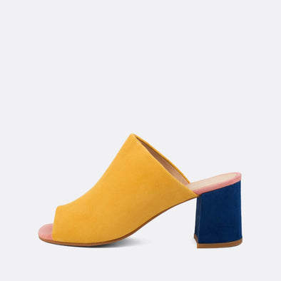 Open heeled mules in brigh yellow, vibrant blue and baby pink.
