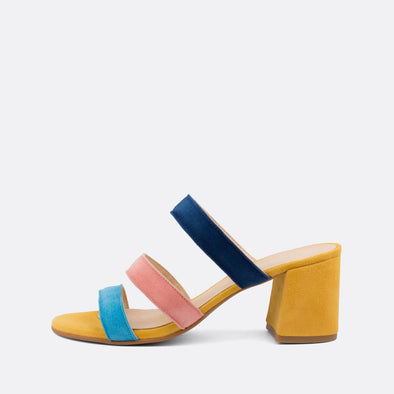 Open heeled mules with multicolored suede straps.
