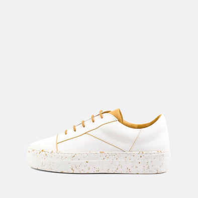 Classic sneakers in white leather with yellow paneled heel tab and matching detailing and laces.