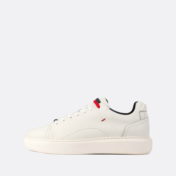 White textured leather low-top sneakers with small red details.