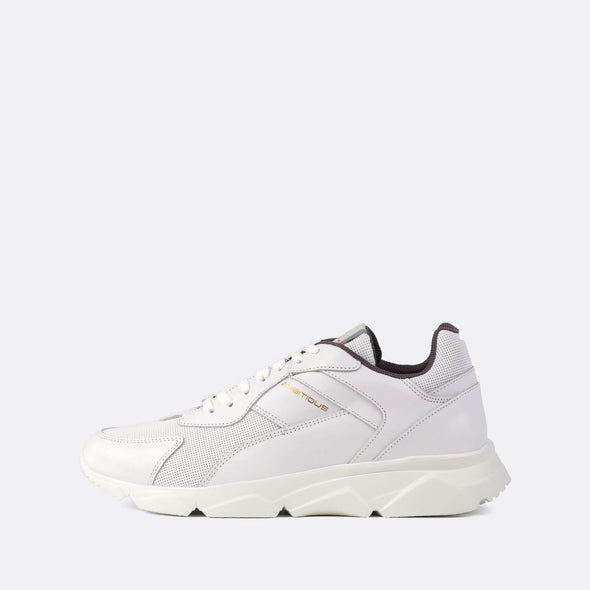 White leather minimalist runners with a vibrant white sole.