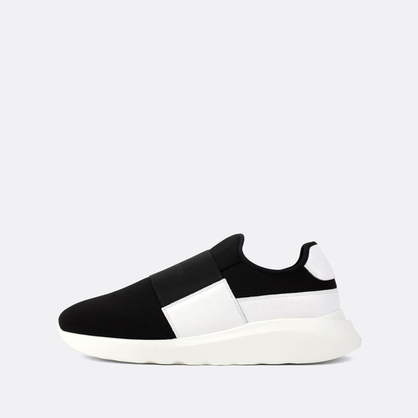 Black and white neoprene runners with a vibrant white sole.