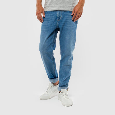 Blue jeans in a slim tapered fit with a laser effect stripe down side seam.