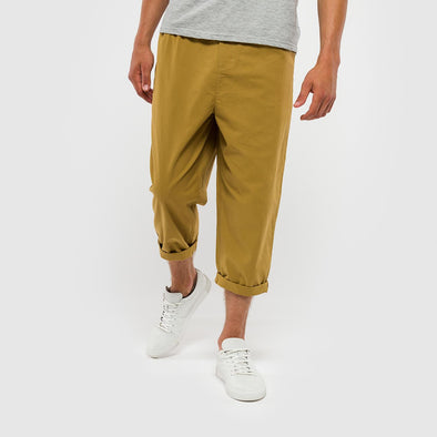 Khaki loose fitted trousers with an elastic waist and back pocket.